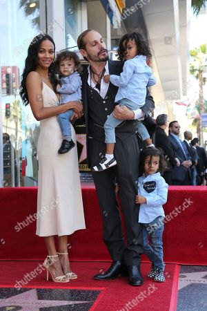 Stock Image of Zoe Saldana, Marco Perego, Bowie Ezio Perego-Saldana, Cy Aridio Perego-Saldana, Zen Perego-Saldana. Zoe Saldana, left, her husband Marco Perego, third right and their children, in no particular order, Bowie Ezio Perego-Saldana, Cy Aridio Perego-Saldana and Zen Perego-Saldana, pose at the ceremony honoring Zoe Saldana with a star at the Hollywood Walk of Fame, in Los Angeles