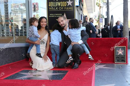 Zoe Saldana, Marco Perego, Bowie Ezio Perego-Saldana, Cy Aridio Perego-Saldana, Zen Perego-Saldana. Zoe Saldana, second left, her husband Marco Perego, second right and their children, in no particular order, Bowie Ezio Perego-Saldana, Cy Aridio Perego-Saldana and Zen Perego-Saldana, pose at the ceremony honoring Zoe Saldana with a star at the Hollywood Walk of Fame, in Los Angeles