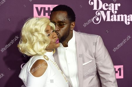 """Stock Image of Sean Combs, Janice Combs. Sean Combs, right, kisses his mother Janice Combs as they arrive at the 3rd annual """"Dear Mama: A Love Letter to Moms"""" at The Theatre at Ace Hotel, in Los Angeles"""