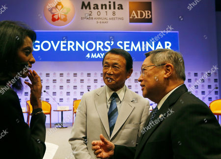 Stock Picture of Taro Aso, Carlos Dominguez, Zeinab Badawi. Japanese Finance Minister and Head of Delegation Taro Aso, center, Philippine Finance Secretary Carlos Dominguez, right, listen to moderator Zeinab Badawi prior to the start of the Governor's Seminar on the second day of the 51st Asian Development Bank in suburban Mandaluyong city, northeast of Manila, Philippines