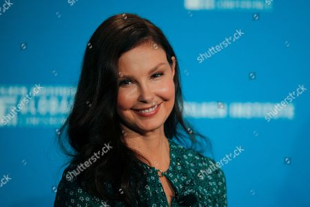 Actress Ashley Judd smiles during a discussion on feminism at the Milken Institute Global Conference, in Beverly Hills, Calif