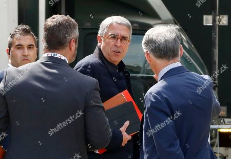 Telecom Italia's former president Arnaud de Puyfontaine leaves at the end of a shareholders meeting, in Rozzano, near Milan, Italy, . The activist hedge fund Elliott Management claimed victory in a shareholder battle for control of the Telecom Italia board, narrowly winning a vote Friday to install a cadre of well-known Italian businessmen as a majority over those loyal to the controlling stakeholder, French entertainment group Vivendi