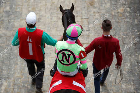 Stock Picture of Jockey Gary Stevens is lead to the track aboard Amy's Challenge for a race before the 144th running of the Kentucky Oaks horse race at Churchill Downs, in Louisville, Ky