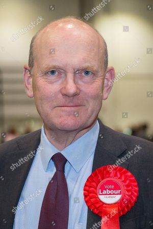 Stock Photo of John Biggs, celebrates after winning the Mayor of Tower Hamlets at the Excel Centre in London.