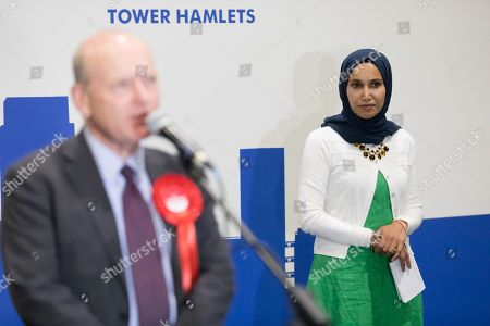 John Biggs, speaking after beating Rabina Khan (R) in the election of the Mayor of Tower Hamlets, at the Excel Centre in London.
