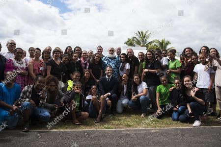 Stock Photo of French President Emmanuel Macron (C) poses for a photo as he visits with students at Michel Rocard high school