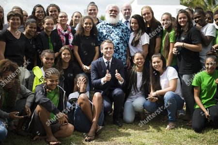 French President Emmanuel Macron (C) poses for a photo as he visits with students at Michel Rocard high school