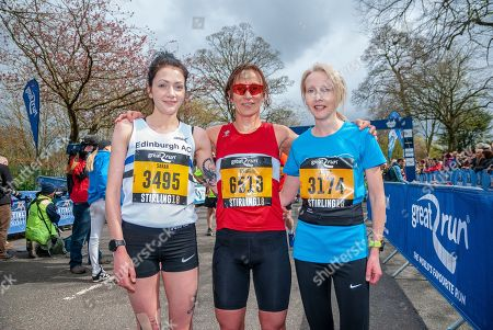 Sarah Brown (L), Kirsty O'Brien (C) and Louise Tyler (R) pose for photographers after completing the 2018 Stirling Scottish Half Marathon.