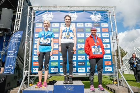Sarah Brown (C), Kirsty O'Brien (L) and Louise Tyler (R) pose for photographers on the podium for the 2018 Stirling Scottish Half Marathon medals for being the first 3 female runners across the line.