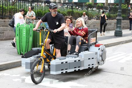 Katie Linendoll and Ashley Eckstein take the inaugural flight in a fully-functioning LEGO Millennium Falcon pedicab comprised of over 20,300 LEGO bricks to celebrate Star Wars Day, in New York