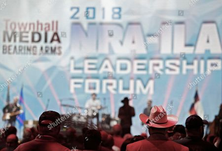 People stand and listen to the Joe Nichols band performs while people are seated to hear US President Donald J. Trump speak at the NRA Forum at the annual meetings inside the Kay Bailey Hutchison Convention Center in Dallas, Texas, USA, 04 May 2018. The NRA Annual Meetings take place over three days.