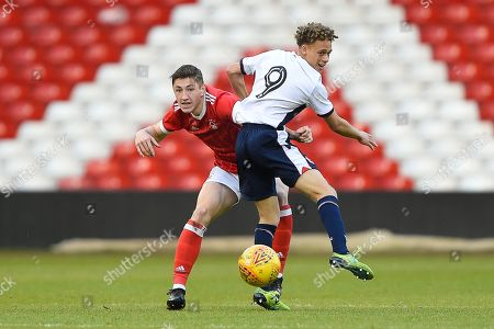 Nottingham Forest U23's Adam Crookes battles with Bolton's U23 Stephen McKenna during the U23 Professional Development League Play-Off Final match between Nottingham Forest and Bolton Wanderers at the City Ground, Nottingham. Picture by Jon Hobley