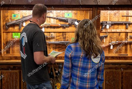 Sean and Lisa Thomas of Fort Worth, Texas, check out a display of weapons at the National Rifle Association Annual Meeting on at the Kay Bailey Hutchison Convention Center in Dallas