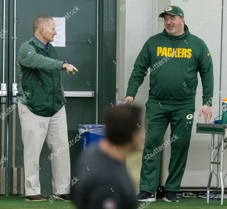 Stock Picture of Green Bay Packers head coach Mike McCarty, right, and Russ Ball, executive vice president/director of football operations, talk during NFL rookie football camp in Green Bay, Wis