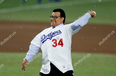 Retired Major League Baseball pitcher Fernando Valenzuela throws the inaugural ball during the regular-season major league baseball game between the San Diego Padres and the Los Angeles Dodgers in Monterrey, Mexico