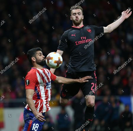 Stock Image of Diego Costa (Club Atletico de Madrid) controls the ball in front of Calum Chambers (Arsenal FC) during the UEFA Europa League Semi Final Second Leg match between Atletico de Madrid and Arsenal FC at the Wanda Metropolitano Stadium in Madrid, Spain.