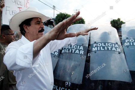 Former President Manuel Zelaya leads members of the opposition to the administration of President Juan Orlando Hernandez in a march to protest the recent decision by the U.S. government to end temporary protected status, or TPS, for tens of thousands of Hondurans who have resided in the United States for nearly two decades, on the streets of Tegucigalpa, Honduras