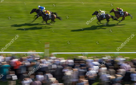 A view of the QIPCO Racing Welfare Handicap Stakes Race as Symbolization trained by Charlie Appleby and ridden by William Buick leads Curiosity trained by Hugo Palmer and ridden by Oisin Murphy