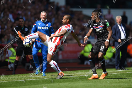 Glen Johnson of Stoke City clears the ball from Wilfried Zaha of Crystal Palace
