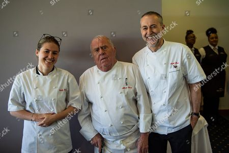 The Roux family, (from L-R) Emily Roux, Albert Roux and Michel Roux Jr pose together ahead of lunch service in the Chez Roux restaurant