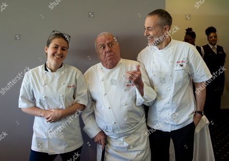 Stock Image of The Roux family, (from L-R) Emily Roux, Albert Roux and Michel Roux Jr pose together ahead of lunch service in the Chez Roux restaurant