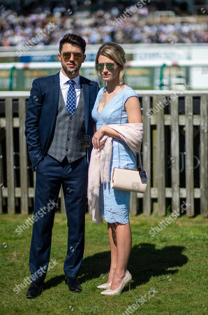 JJ Hamblett of Union J, Newmarket racecourse ambassador, poses alongside his girlfriend on the racecourse