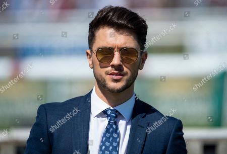 JJ Hamblett of Union J, Newmarket racecourse ambassador, poses on the racecourse