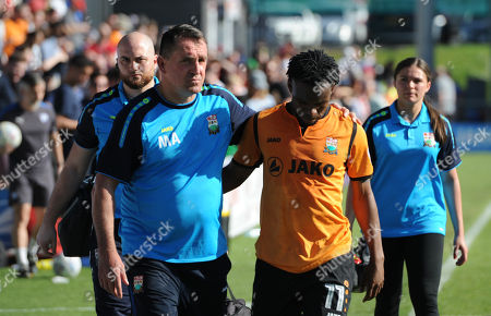 Manager Martin Allen of Barnet looks dejected at the end of the game and consoles Shaquile Coulthirst of Barnet