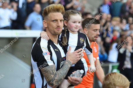 Notts County defender Daniel Jones (23) walks out on to the pitch with his daughter during the EFL Sky Bet League 2 match between Notts County and Luton Town at Meadow Lane, Nottingham. Picture by Jon Hobley
