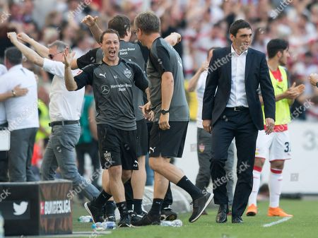 Stuttgart's coach Tayfun Korkut (R) reacts after Stuttgart's Mario Gomez (not in the picture) scored the 2-0 goal  during the German Bundesliga soccer match between VfB Stuttgart and TSG 1899 Hoffenheim in Stuttgart, Germany, 05 May 2018.