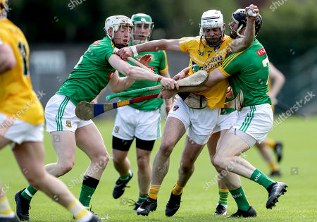 Meath vs Antrim. Antrim's Neil McManus with Damien Healy and Shane Brennan of Meath