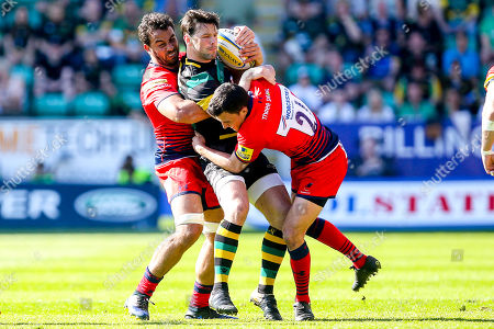 Ben Foden of Northampton Saints is tackled by Marco Mama and Jonny Arr of Worcester Warriors