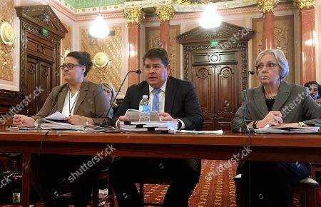 Stock Photo of Michael Hoffman, Amy Romano, Gwen Diehl. Michael Hoffman, center, senior adviser to Illinois Gov. Bruce Rauner on the response to the Legionnaires' disease crisis at the Quincy veterans' home, testifies about progress on the administration's plans to rebuild the Quincy facilities before a joint hearing of the House and Senate Veterans Affairs Committees in the state Capitol in Springfield. He is accompanied by Amy Romano, left, acting director of the Capital Development Board, and Gwen Diehl, of the Illinois Department of Veterans' Affairs. The administration released a report last week that recommends new construction at the Quincy campus costing as much as $245 million