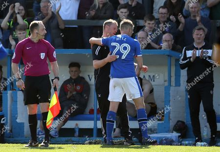 Clint Hill of Carlisle United (29) is applauded by Newport County manager Michael Flynn after being subbed off