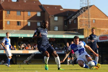 Tom Broadbent of Bristol Rovers clears the ball from Marc-Antoine Fortune of Southend United
