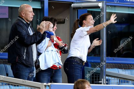 Stock Photo of Coleen Rooney waves to husband Wayne and her boys as they do a lap of honour at the end of the Premier League match between Everton and Southampton at Goodison Park, Liverpool. Picture by Craig Galloway