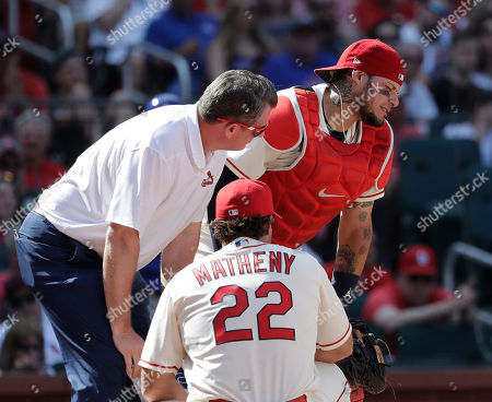 Chris Conroy, Yadier Molina, Mike Matheny. St. Louis Cardinals trainer Chris Conroy, left, and manager Mike Matheny (22) tend to catcher Yadier Molina after Molina was injured on a pitch during the ninth inning of a baseball game against the Chicago Cubs, in St. Louis