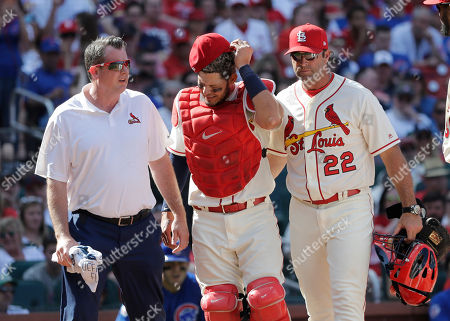 Chris Conroy, Yadier Molina, Mike Matheny. St. Louis Cardinals trainer Chris Conroy, left, and manager Mike Matheny (22) walk with catcher Yadier Molina back to the dugout after Molina was injured during the ninth inning of the team's baseball game against the Chicago Cubs, in St. Louis