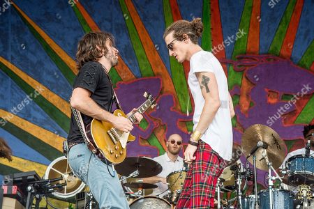 Zack Feinberg, David Shaw. Zack Feinberg, left, and David Shaw of The Revivalists performs at the New Orleans Jazz and Heritage Festival, in New Orleans