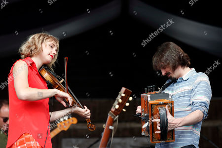 Stock Picture of Violinist Kelli Jones and accordionist Chris Stafford of the Louisiana neuvo-cajun band Feufollet perform at the New Orleans Jazz & Heritage Festival in New Orleans