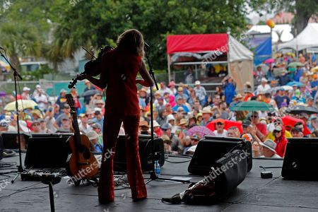 Stock Photo of Violinist Kelli Jones of the Louisiana neuvo-cajun band Feufollet performs at the New Orleans Jazz & Heritage Festival in New Orleans