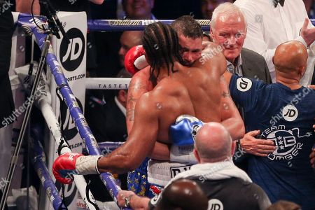 David Haye congratulates Tony Bellew with Barry Hearn  looking on at the O2 Arena, London. Picture by Phil Duncan