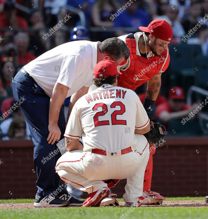 Chris Conroy, Yadier Molina, Mike Matheny. St. Louis Cardinals trainer Chris Conroy, left, and manager Mike Matheny (22) attend to catcher Yadier Molina after Molina was injured on a pitch during the ninth inning of a baseball game against the Chicago Cubs, in St. Louis