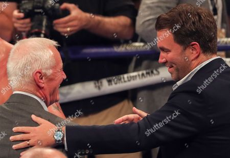 Eddie Hearn right and his Father Barry Hearn  celebrate  Bellew Win