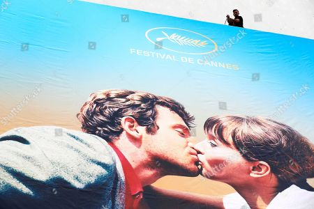 A worker sets up the official poster of the 71st annual Cannes Film Festival on the Palais des Festivals facade, in Cannes, France, 06 May 2018. The poster displays a photogram of French actors Anna Karina (R) and Jean-Paul Belmondo (L). The festival runs from 08 to 19 May.