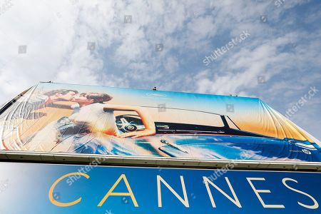 Workers set up the official poster of the 71st annual Cannes Film Festival on the Palais des Festivals facade, in Cannes, France, 06 May 2018. The poster displays a photogram of French actors Anna Karina (R) and Jean-Paul Belmondo (L). The festival runs from 08 to 19 May.