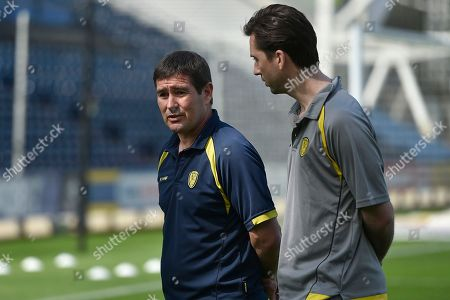 Stock Image of Burton Albion manager Nigel Clough chats to Burton Albion defender and club captain Shaun Barker (25) prior to the EFL Sky Bet Championship match between Preston North End and Burton Albion at Deepdale, Preston. Picture by Richard Holmes