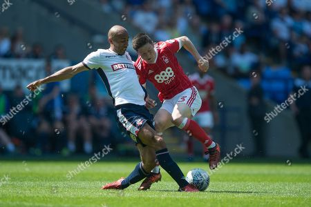Stock Photo of Bolton Wanderers midfielder Karl Henry (24) tackles Nottingham Forest forward Joe Lolley (23) during the EFL Sky Bet Championship match between Bolton Wanderers and Nottingham Forest at the Macron Stadium, Bolton. Picture by Jon Hobley