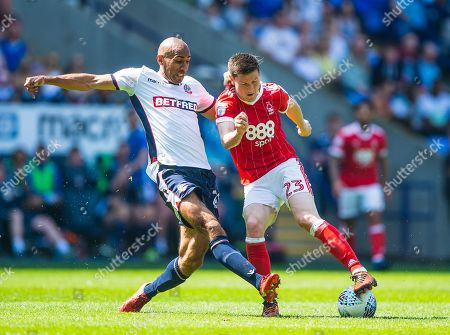 Bolton Wanderers midfielder Karl Henry (24) tackles Nottingham Forest forward Joe Lolley (23) during the EFL Sky Bet Championship match between Bolton Wanderers and Nottingham Forest at the Macron Stadium, Bolton. Picture by Jon Hobley