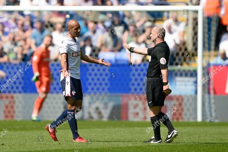 Referee Scott Duncan has words with Bolton Wanderers midfielder Karl Henry (24) during the EFL Sky Bet Championship match between Bolton Wanderers and Nottingham Forest at the Macron Stadium, Bolton. Picture by Jon Hobley